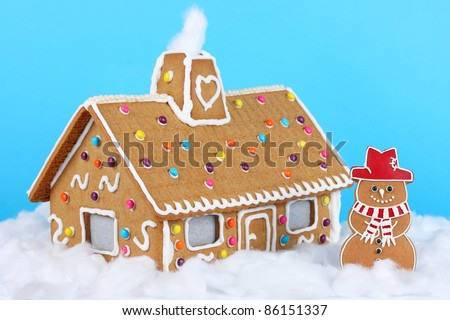 Gingerbread house with Gingerbread Snowman - stock photo