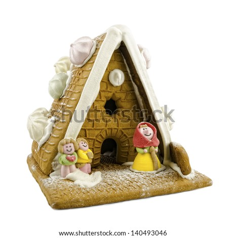 Gingerbread house with little people on a white background - stock photo