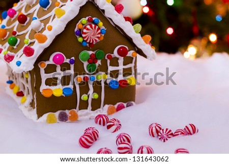 Gingerbread house with round  peppermint candies. - stock photo
