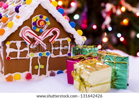 Gingerbread house with small presents. - stock photo