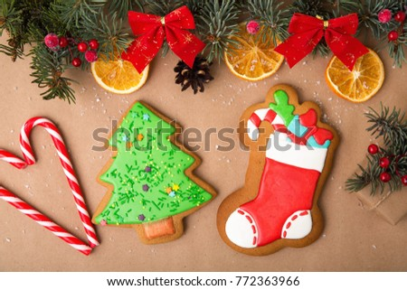 Gingerbread in the form of a boot with gifts. Christmas homemade gingerbread on a wooden table. Gingerbread, sweets, dried orange, candied fruit - traditional Christmas decor.