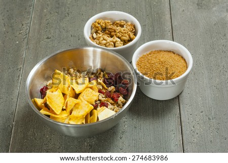 gingerbread ingredients in mixing bowl, rusty wooden table background - stock photo