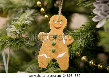 Gingerbread man and pine cones on a Christmas tree