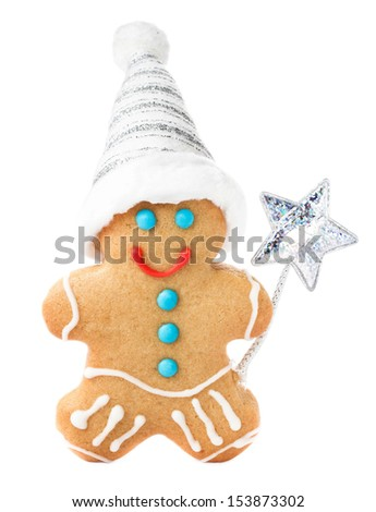 Gingerbread Man Christmas Cookie with Santa hat and magic stick isolated on white background, closeup. - stock photo