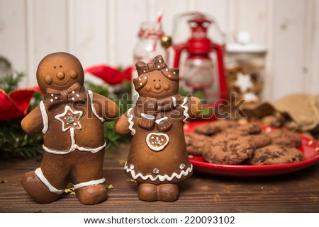 Gingerbread man with Christmas decorations on a wooden table