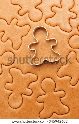 Gingerbread men cookies background. Christmas baking texture with cutter