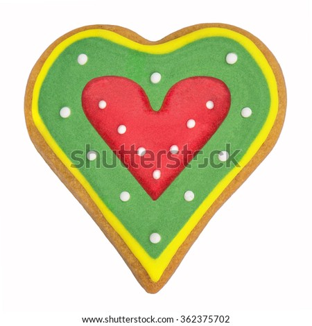 Gingerbread red heart cookie on a white background - stock photo
