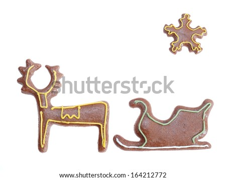 Gingerbread reindeer sleigh and star with color icing shot on white background