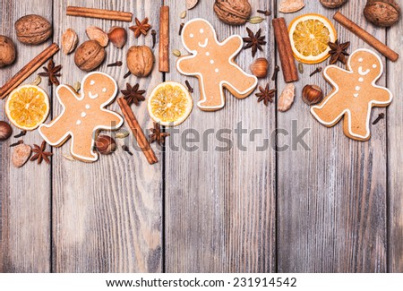 Gingerbreads with spices on the wooden table. Christmas aroma decor