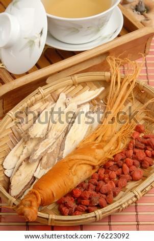 Ginseng?Codonopsitis Radix?Red dry goji berries   in bamboo basketdry - stock photo