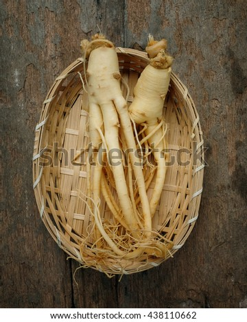 Ginseng on wood background,Korean ginseng on bamboo weave. - stock photo
