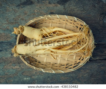 Ginseng on wood background,Korean ginseng on bamboo weave - vintage effect style. - stock photo