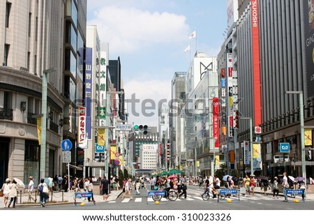 Ginza, Tokyo/Japan - Aug 9, 2015: Famous Ginza shopping area turned into a pedestrian heaven on a Sunday - stock photo
