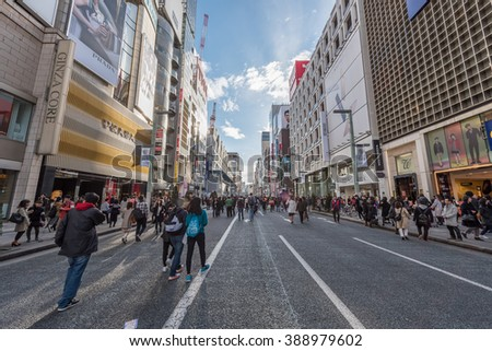 GINZA - TOKYO - JAPAN - FEB 2016 : Ginza Luxurious Walking Shopping Street during Weekend (Traffic Closed) on 13 Feb 2016