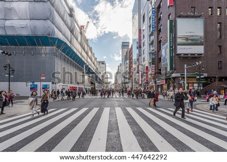 GINZA - TOKYO - JAPAN - FEB 2016 : Zebra Crossing of Ginza Shopping Street (Traffic Closed during Weekend) on 13 Feb 2016
