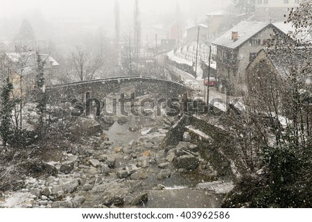 Giornico, Switzerland - 7 february 2016: the village of Giornico under snowfall in Leventina valley on the Swiss alps