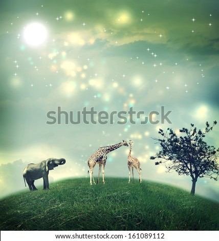 Giraffes and an elephant on a hilltop under the moon - stock photo