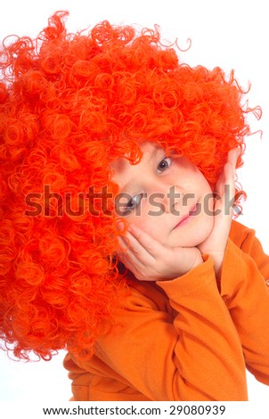 Girl - a thoughtful clown is in a red wig