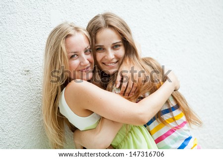 girl against a wall and fooled laugh - stock photo