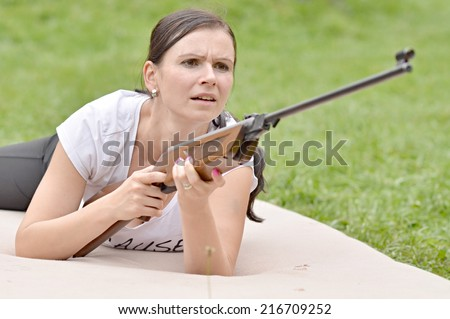 girl aiming a pneumatic rifle  - stock photo