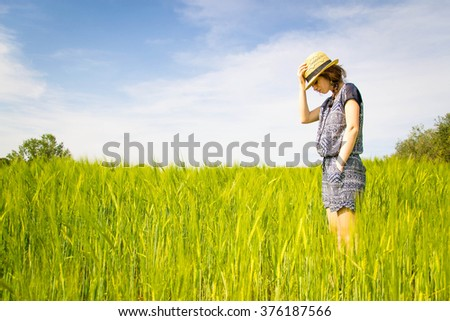 Girl alone in a countryside - lifestyle, people and outdoor concept - stock photo