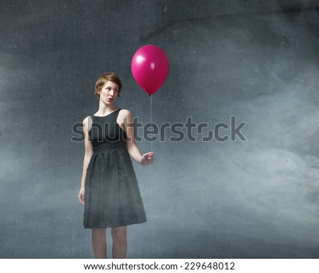 girl alone with helium balloon on hand - stock photo