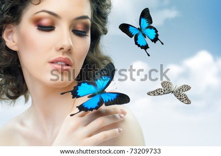 girl and a beautiful butterfly - stock photo
