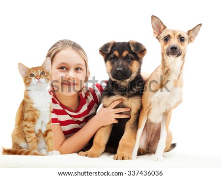 girl and a cat and a dog - stock photo