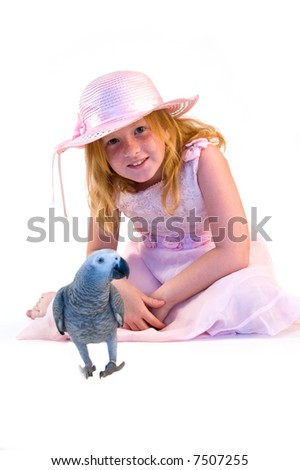 girl and a grey red-tale parrot - stock photo
