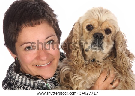 Girl and american cocker spaniel over a white background