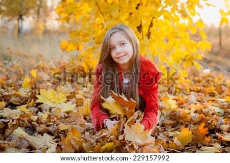 Girl and autumn landscape