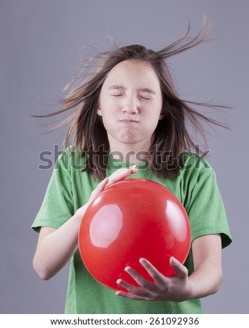 Girl and balloon blast. - stock photo
