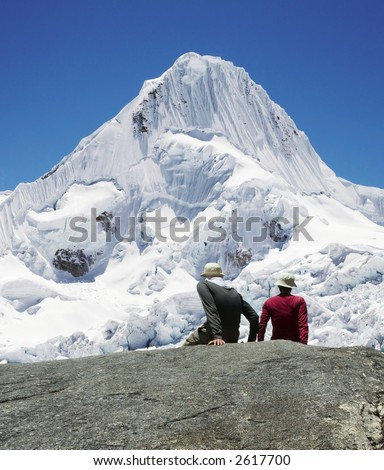 Girl and boy are looking to Alpamayo peak - stock photo