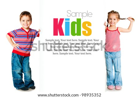 girl and boy beside a white blank with sample text - stock photo