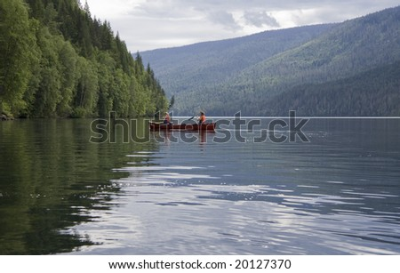 Girl and boy canoeing, Canada - stock photo