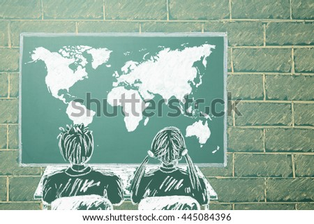 Girl and boy in front of World map on a display - stock photo