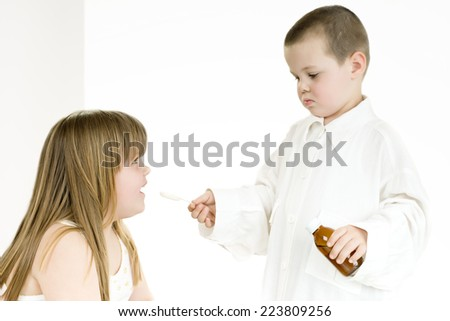 girl and boy playing doctor/girl and boy playing doctor - stock photo