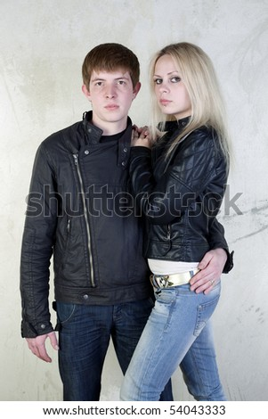Girl and boy posing on a vintage background - stock photo