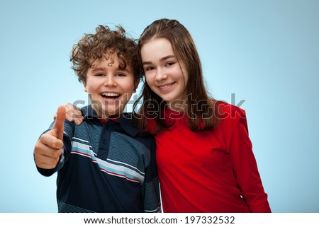 Girl and boy showing OK sign - stock photo