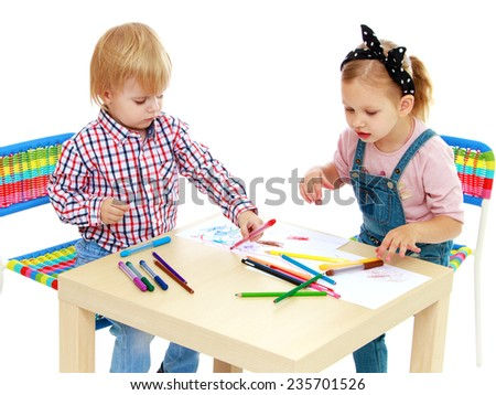 Girl and boy sitting at the table draw.Childhood education development in the Montessori school concept. Isolated on white background.