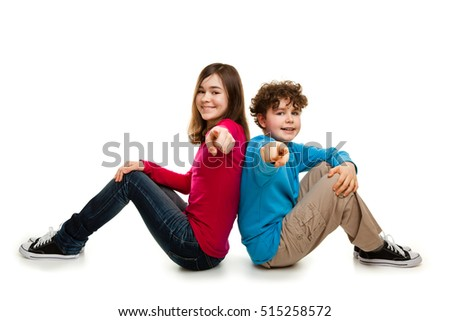 Girl and boy sitting on white background