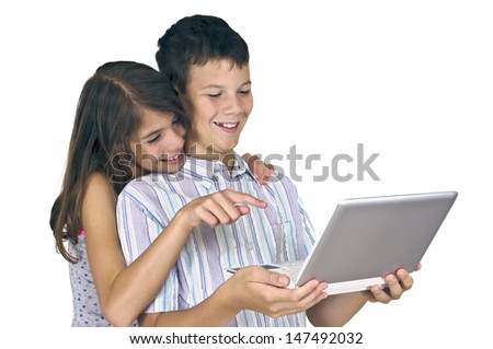 Girl and boy watching laptop computer