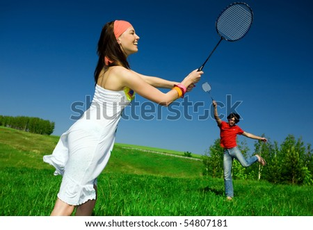 Girl and boy with rackets - stock photo