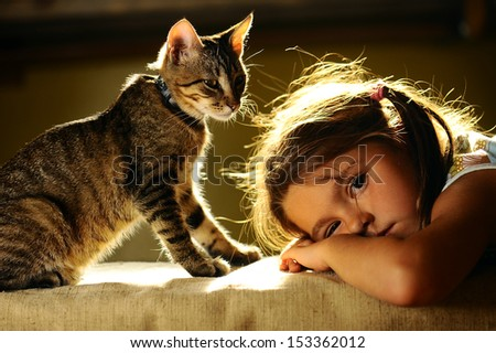 girl and cat, friends. - stock photo