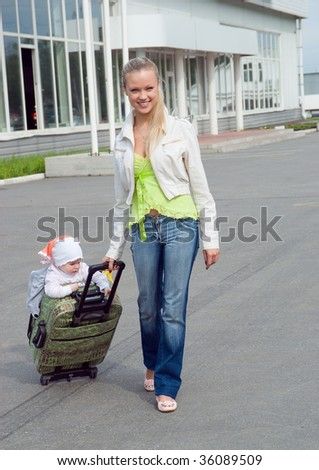 girl and child in valise.family goes to travel