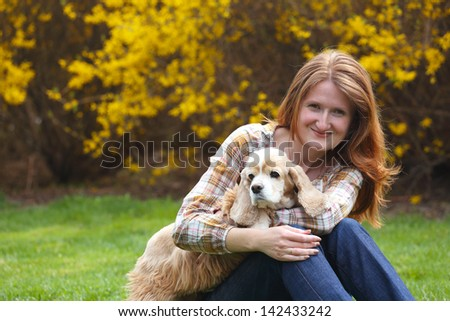 girl and dog on a park  - stock photo