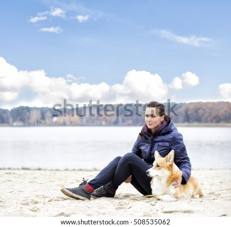 girl and dog outdoors