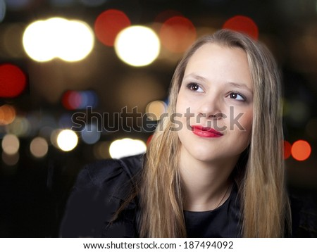 Girl and fires of the night city. - stock photo