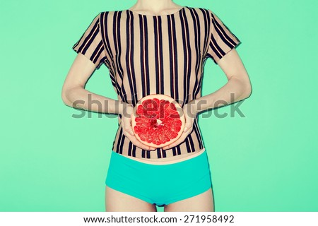 Girl and Grapefruit, Vanilla, fashion style, Minimal - stock photo