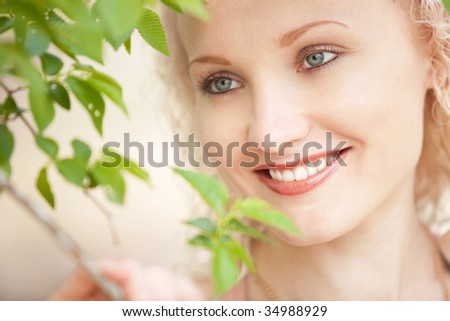 girl and green leaves - stock photo